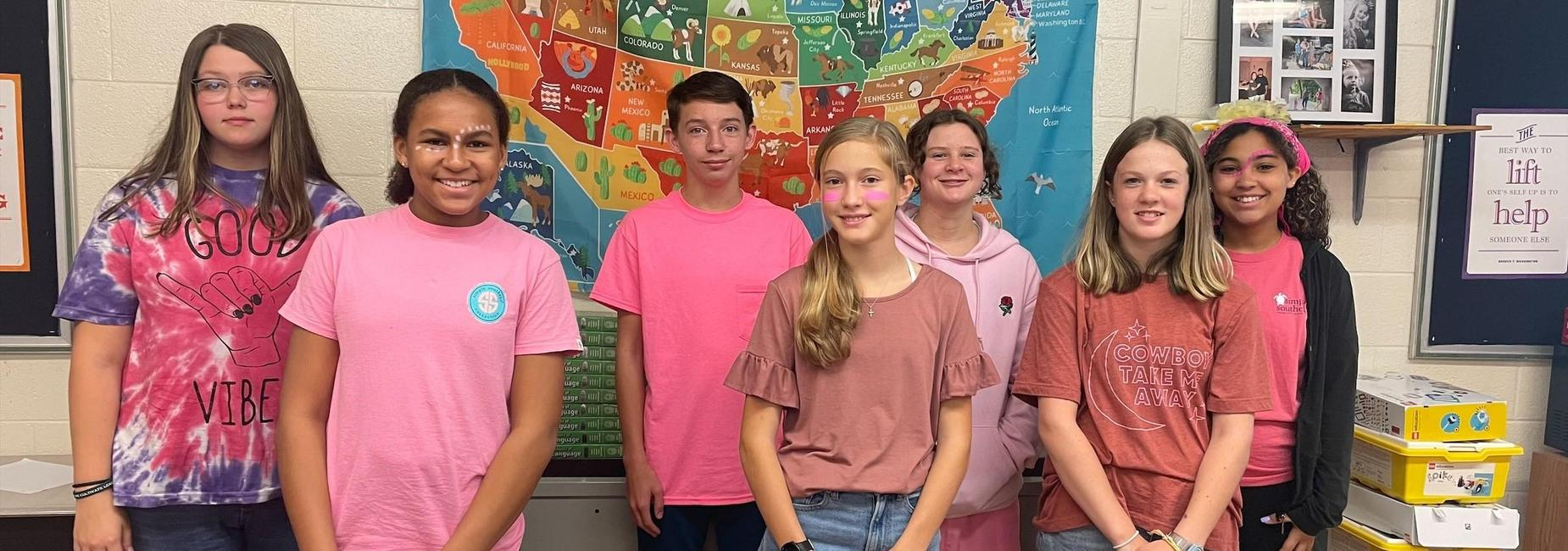a picture of students dressed for Pink Out