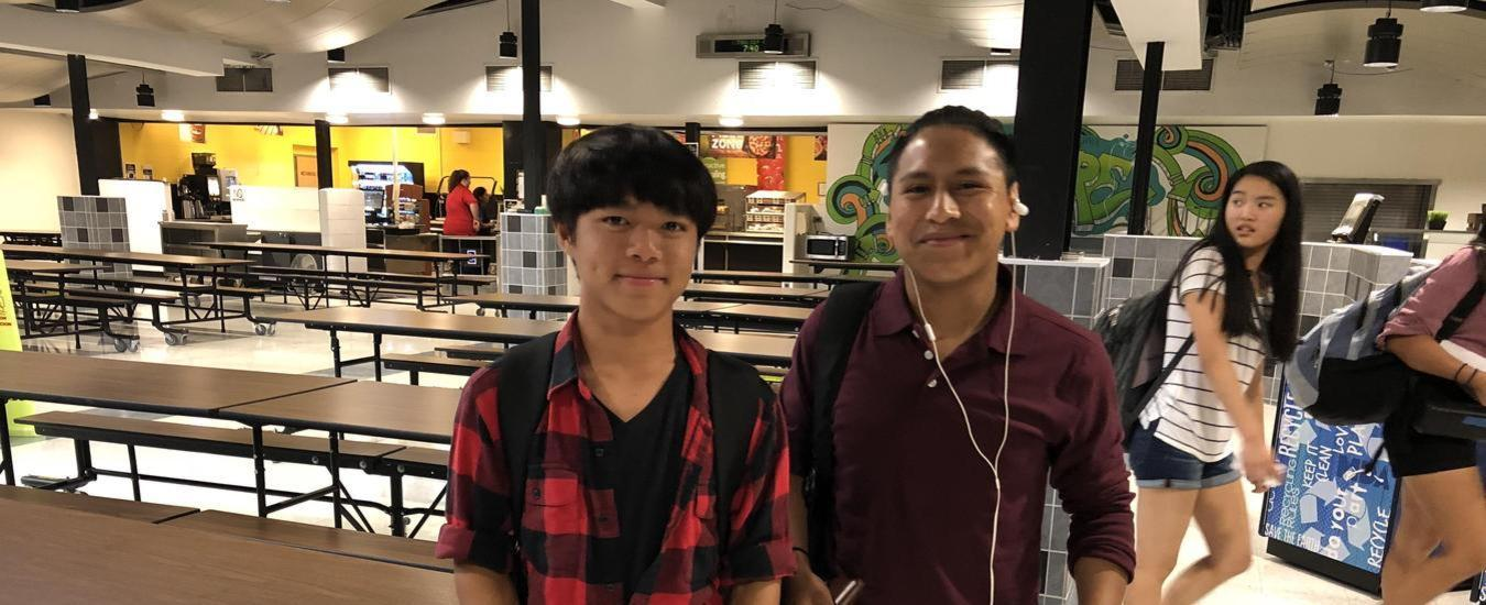 Two smiling boys in cafeteria