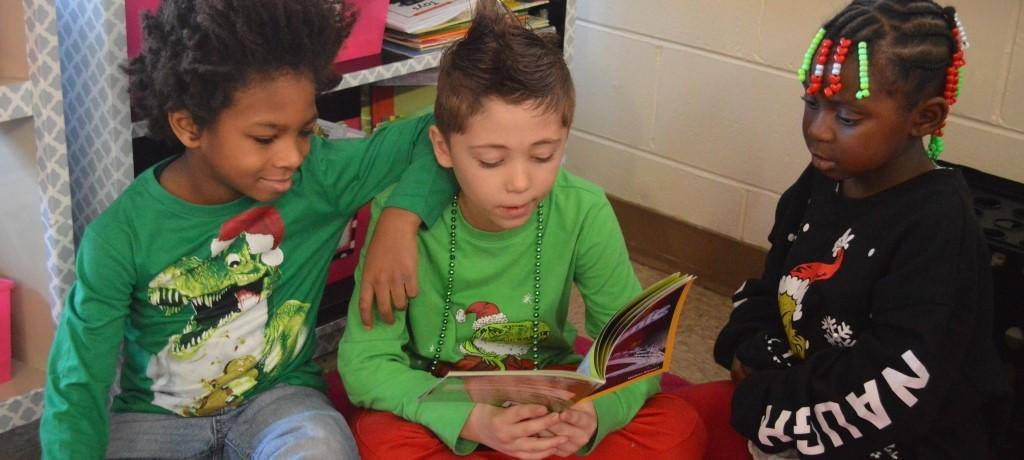 3 students reading
