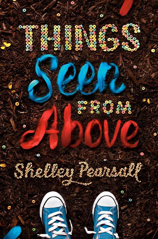 """The image is of a book cover. The book is called """"Things Seen From Above"""" by Shelley Pearsall. The book cover has a background that is brown playground dirt. The words in the title are stylized to look like perler beads and feathers. There is a pair of blue converse sneakers at the bottom of the cover. Image courtesy of https://www.shelleypearsall.com/."""