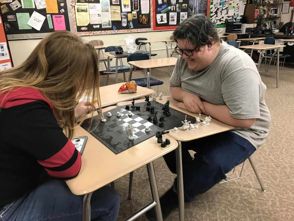 Two students playing chess