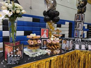 display table filled with a lovely display of donuts and picture frames with famous artists and screen cut