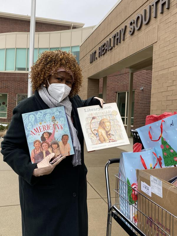 Gwen Ivory Robinson with books donated