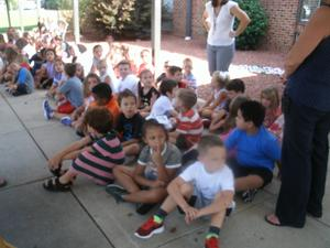 Students practice dismissal on the first day of school.