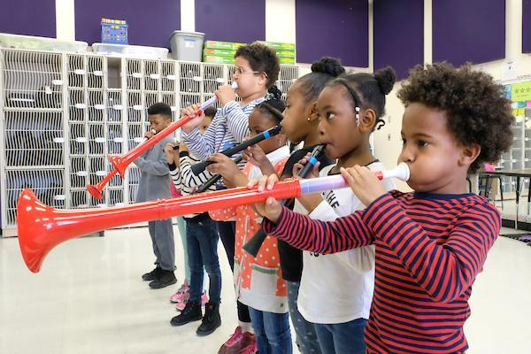 Students playing an instrument