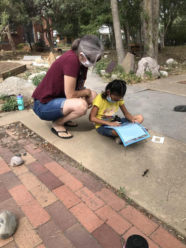 A student with a teacher working outside