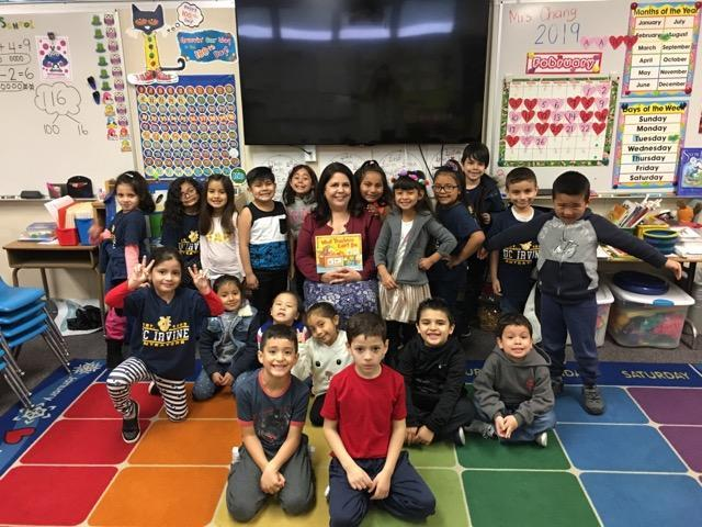Dr Rios reading to Kindergarten students