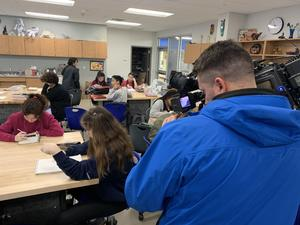 KXAN filming Grace in class as she sketches.