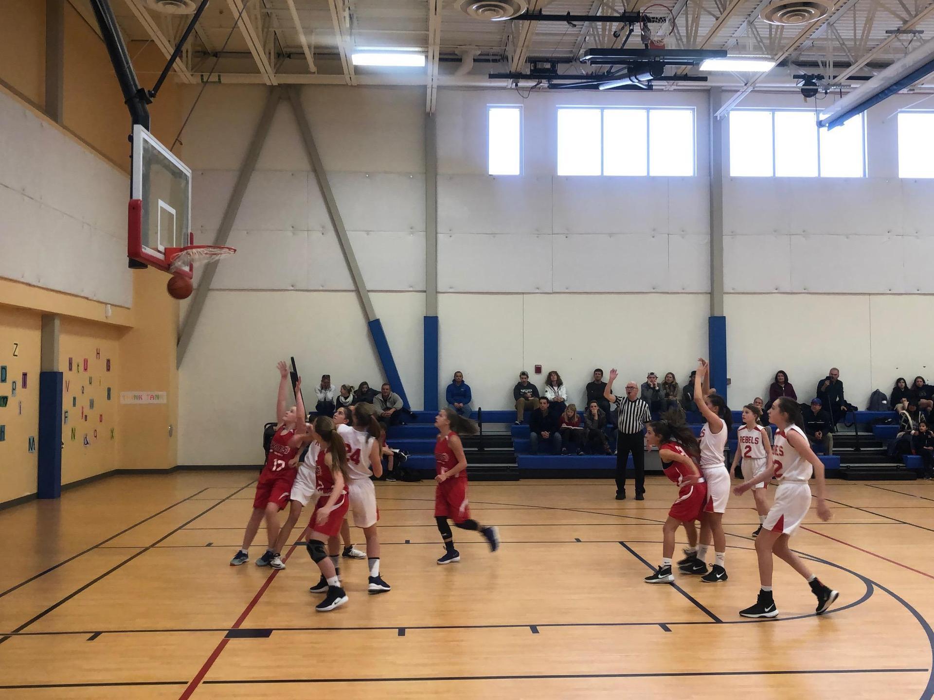 girls basketball player making free throw attempt toward camera