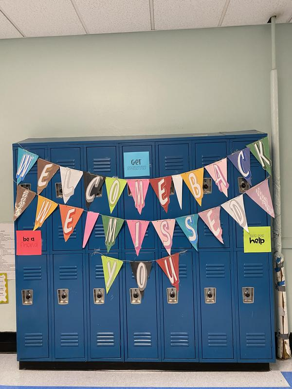 Triangle streamers hung on lockers spelling