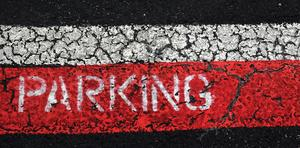 Parking sign painted on street