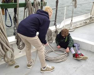 After the sails are raised, its time to coil the excess rope