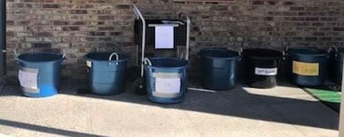 Completed homework drop off buckets