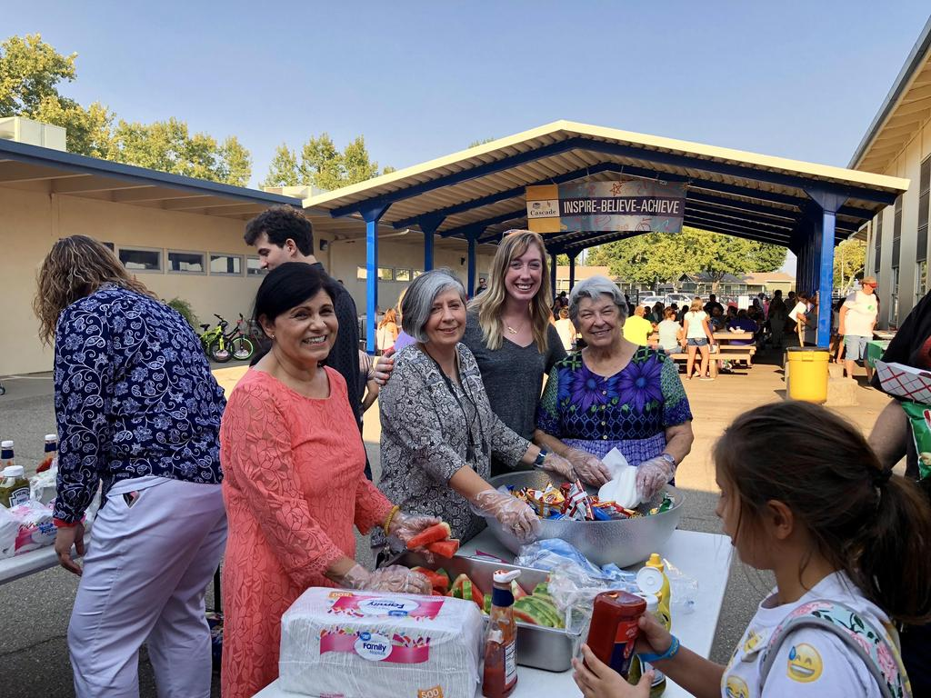 Teachers serving food during Back to School nite