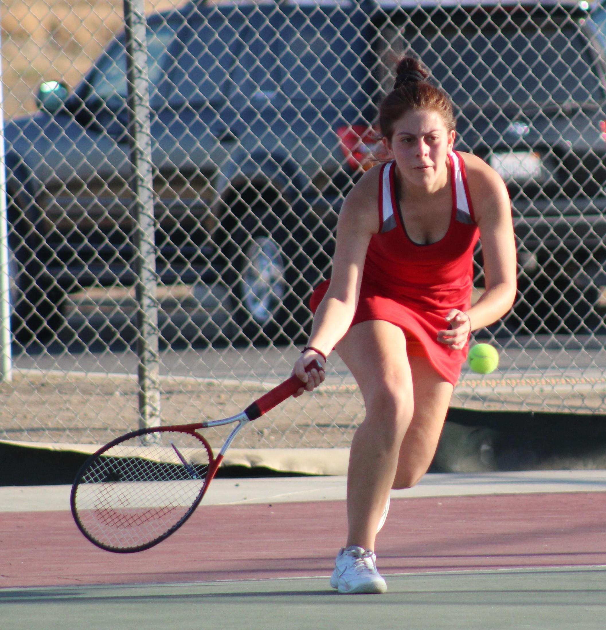 Girls playing tennis against Woodlake.