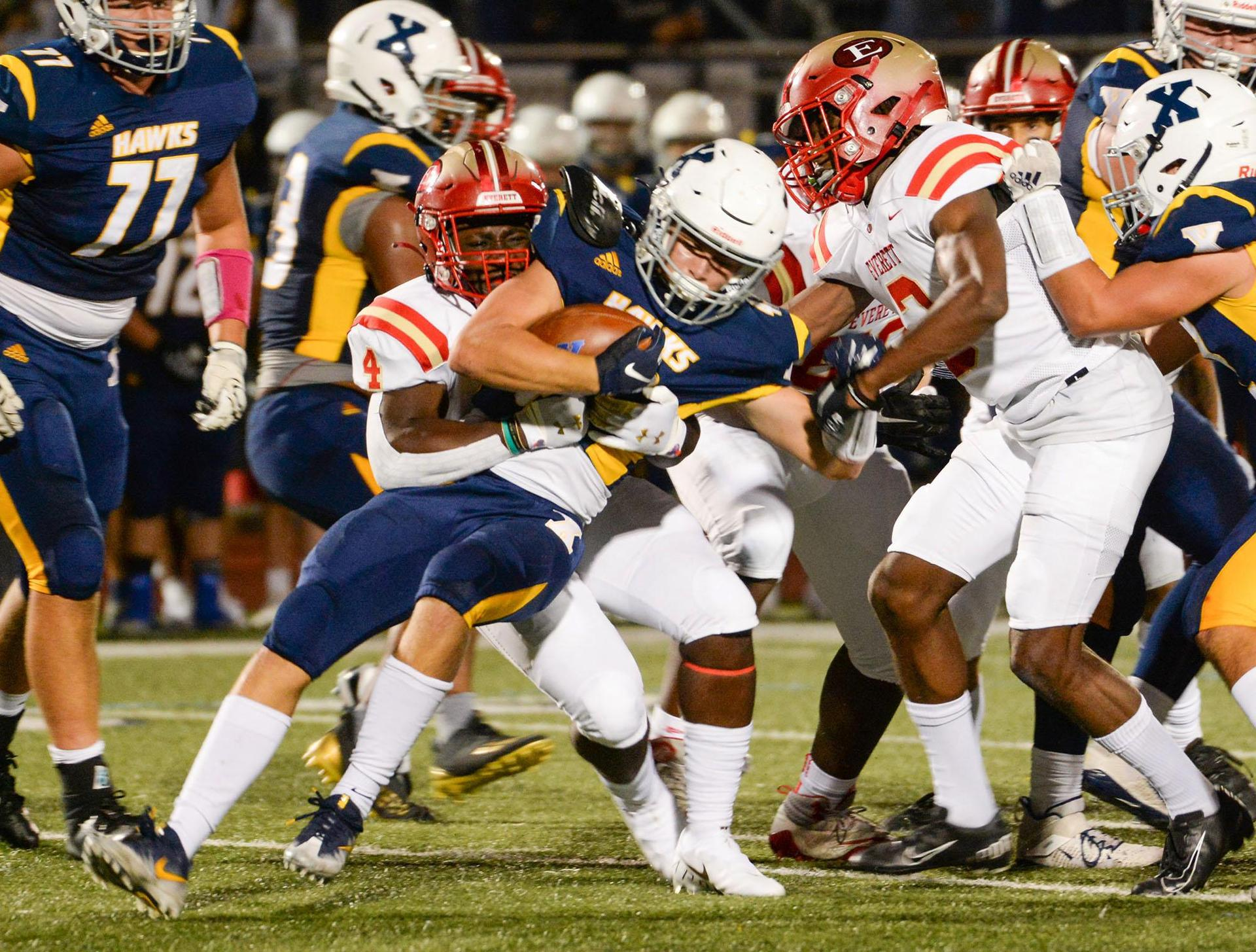 A slew of EHS defenders make a tackle