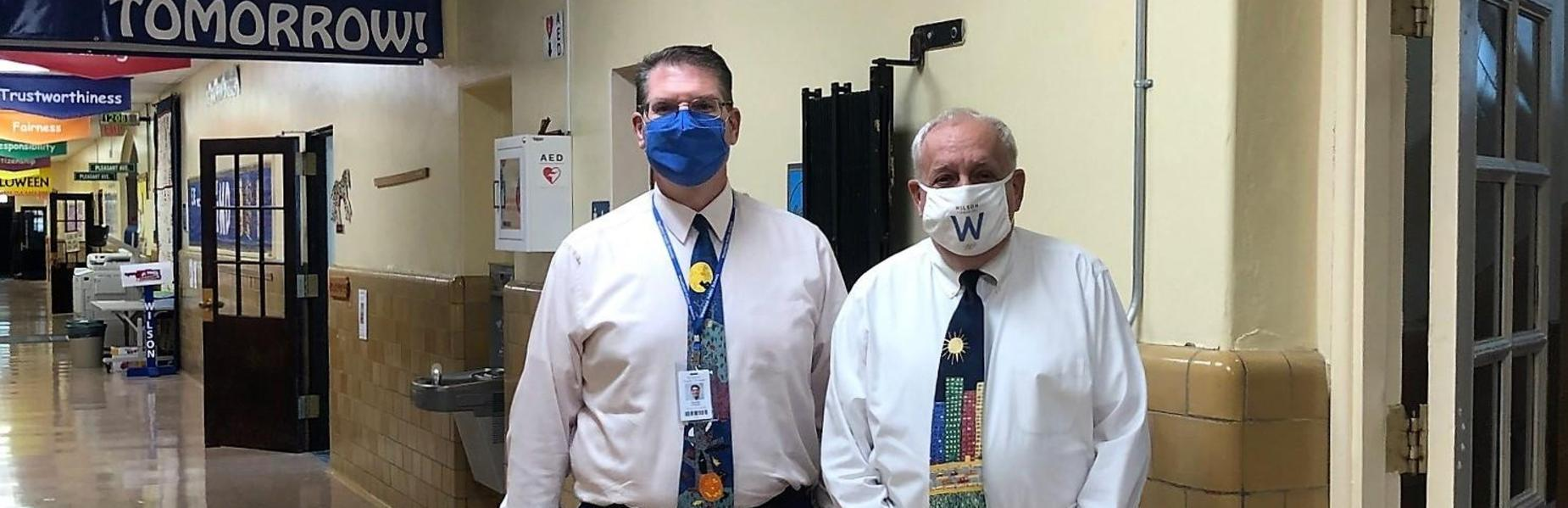 Photo of Wilson guidance counselor and principal wearing masks.