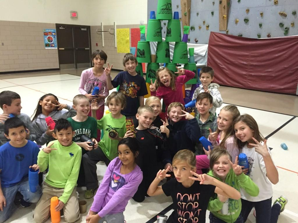 students pose with their cups and pails