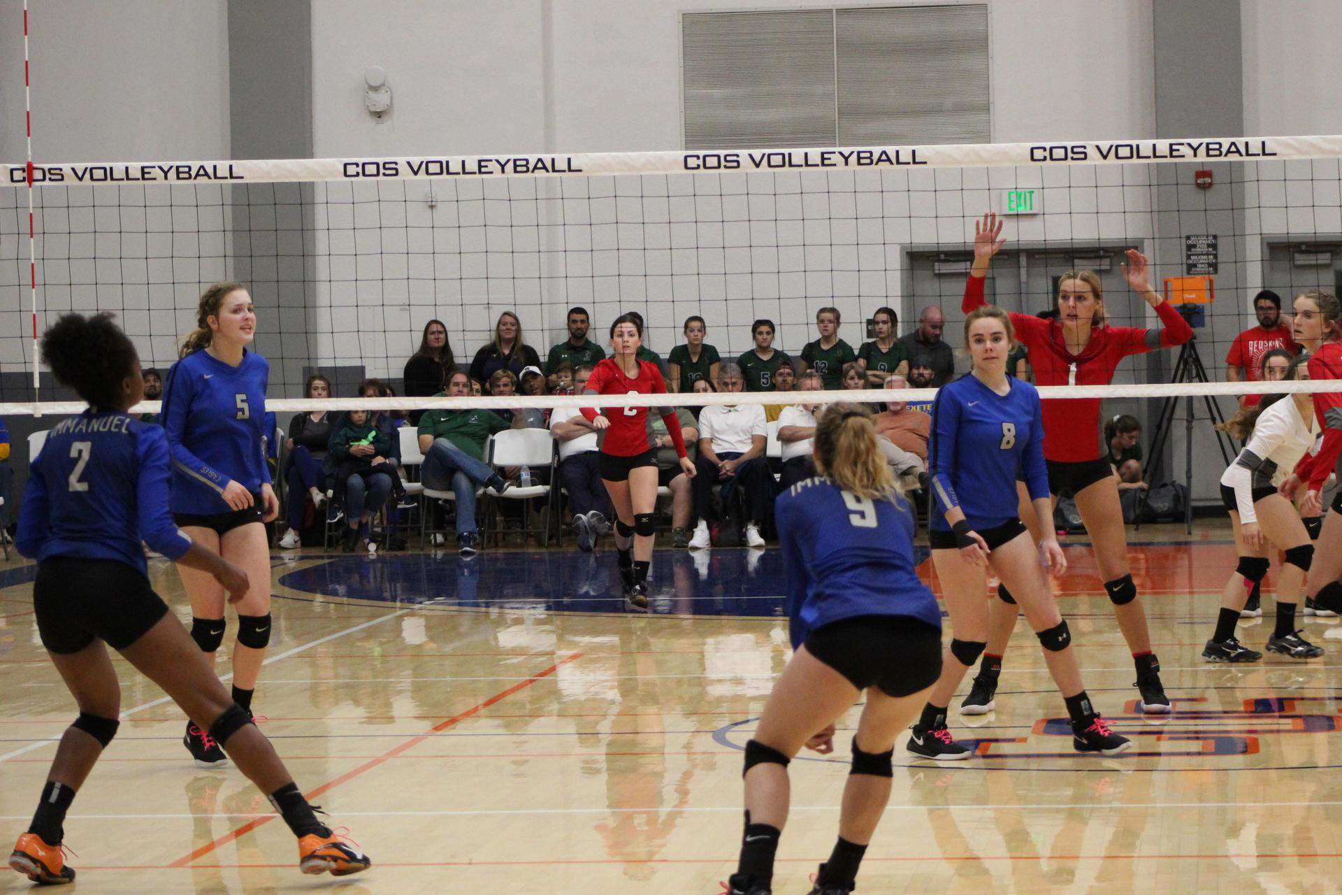 Girls playing volleyball against Immanuel