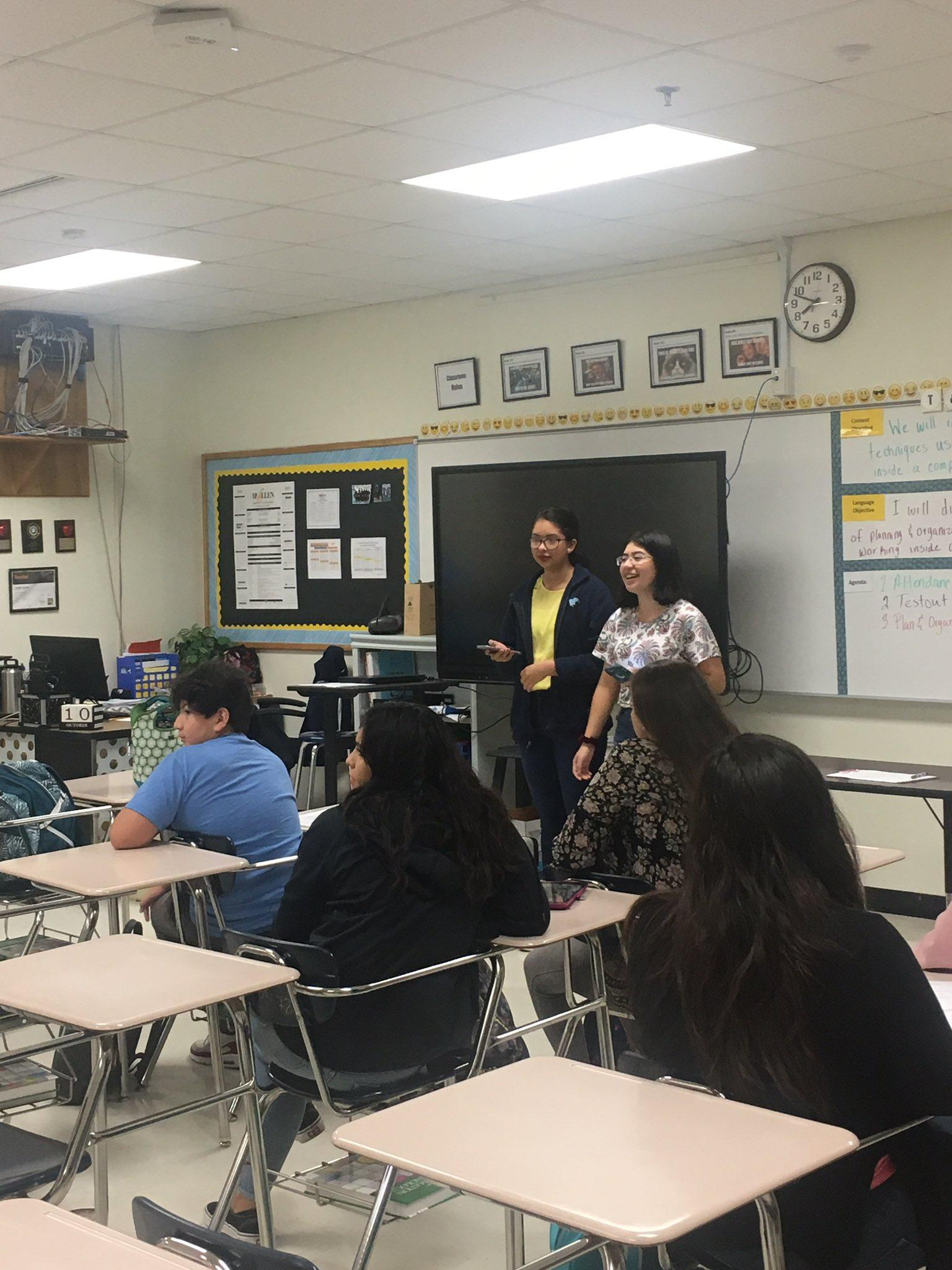 two students presenting in front of class