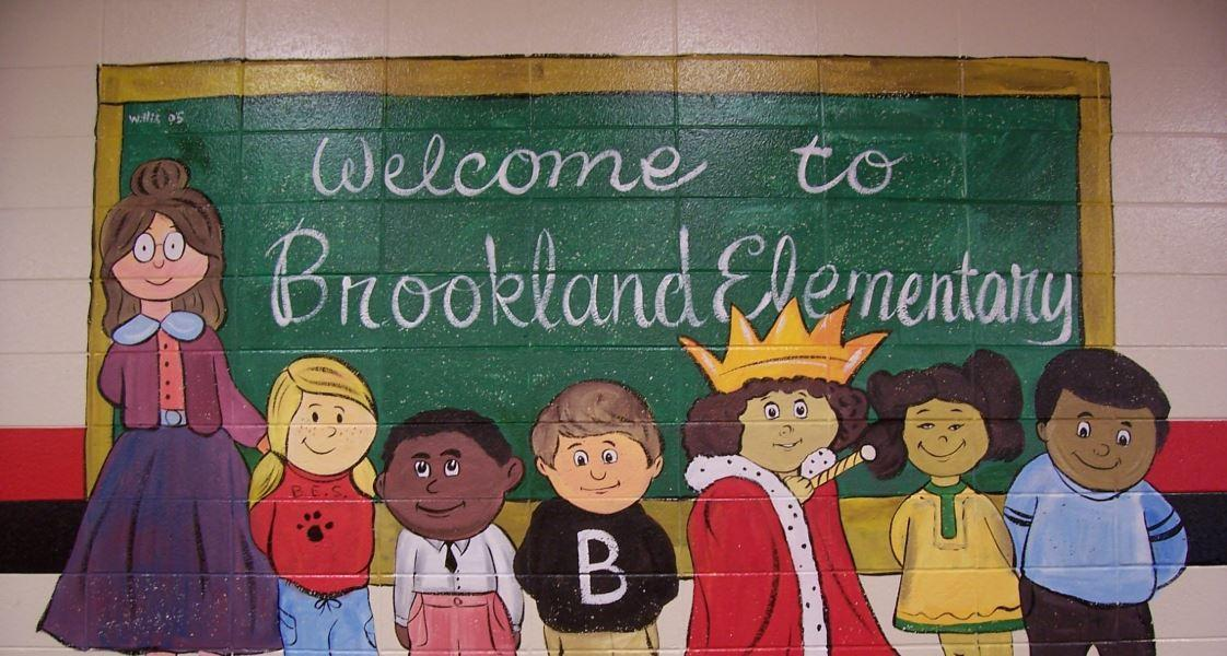 wall mural of cartoon students that says, welcome to Brookland Elementary