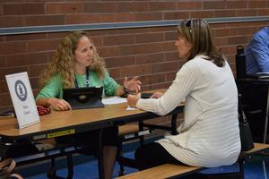 two women talking at a lunch table