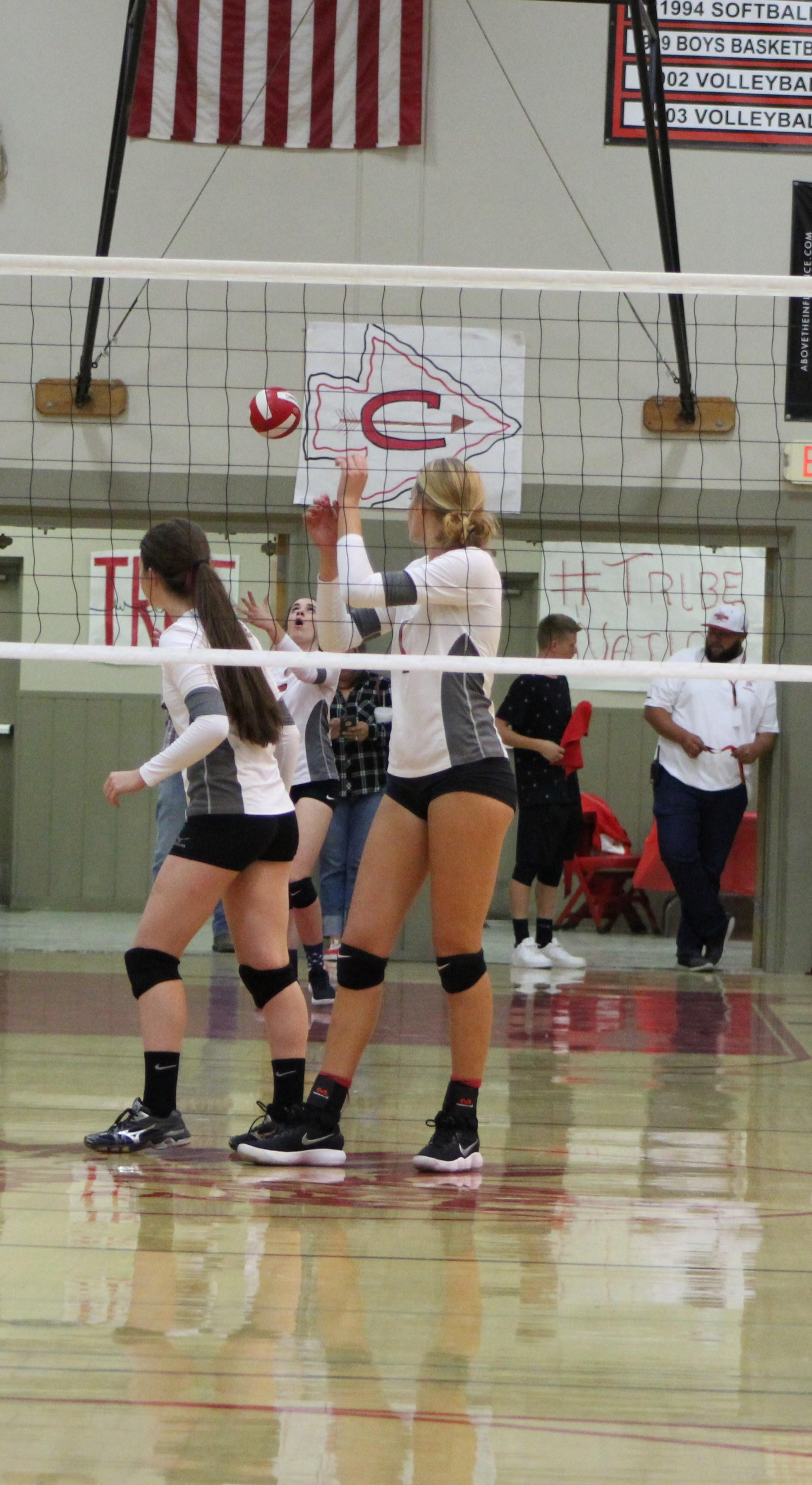 Girls playing volleyball against Liberty.