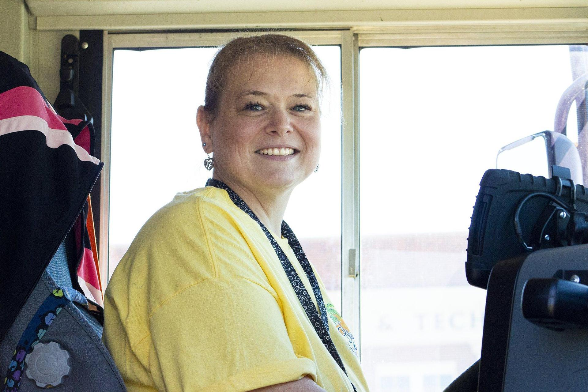 woman in drivers seat of school bus