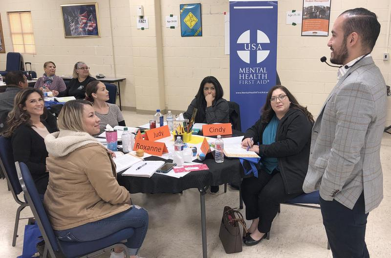 Edinburg CISD Licensed Professional Counselor Josue Gutierrez (standing) talks to a group of parents attending the Youth Mental Health First Aid Program at the Transportation Annex Building in Edinburg.