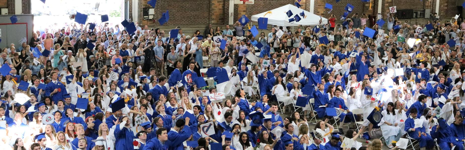 Photo of WHS Class of 2019 throwing caps into air.