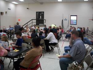Students and parents participate in lego math activities.
