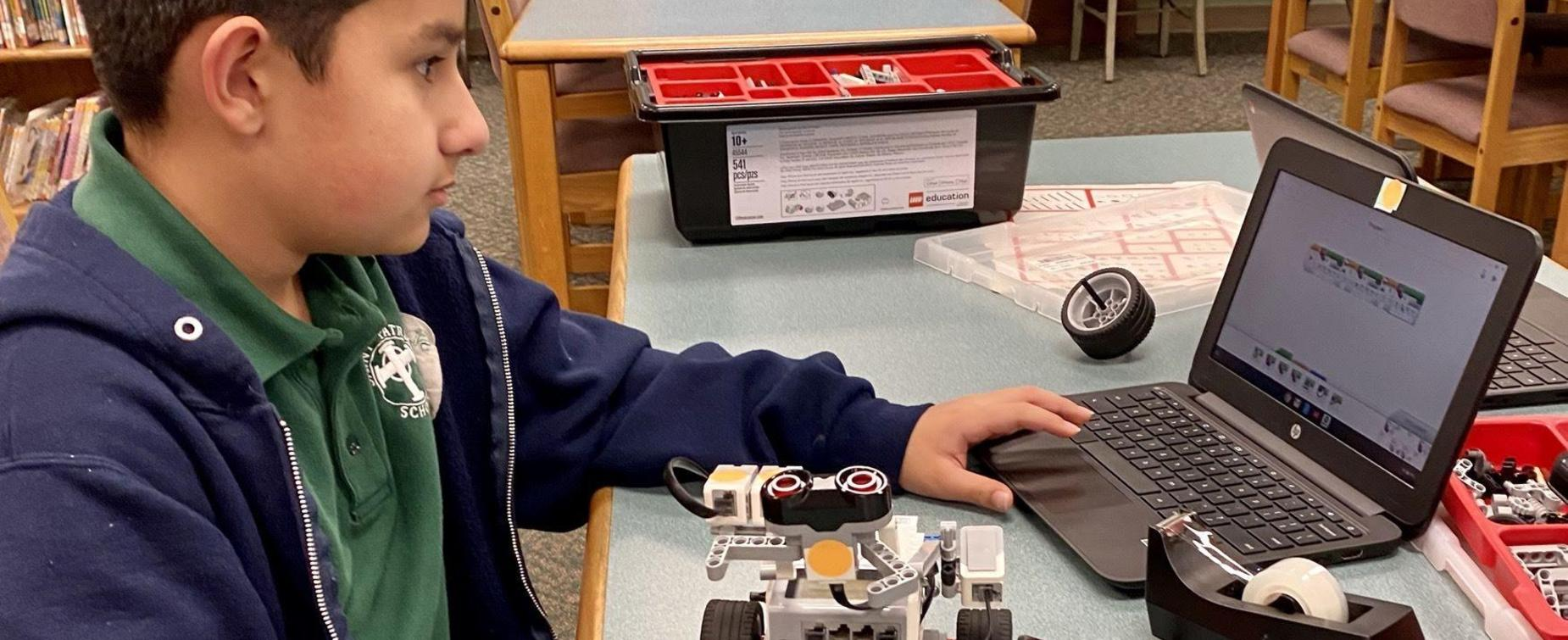 Student creating with robots