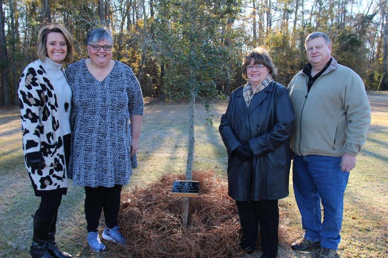 Pictured from left to right are Angie Rye (Chief Academic Officer for Lexington Three), Sonya Bryant (Principal of B-L High School and newly-named SC Principal of the Year), Lexington Soil and Water Conservation District Commissioner Barbara Padget, and District Manager John Oxner. On Thursday, December 19th, the Lexington Soil and Water Conservation District dedicated a live oak tree on the grounds of Batesburg-Leesville High School in honor of Mrs. Bryant, who is the first educator in Lexington Three to be named South Carolina's Secondary Principal of the Year.