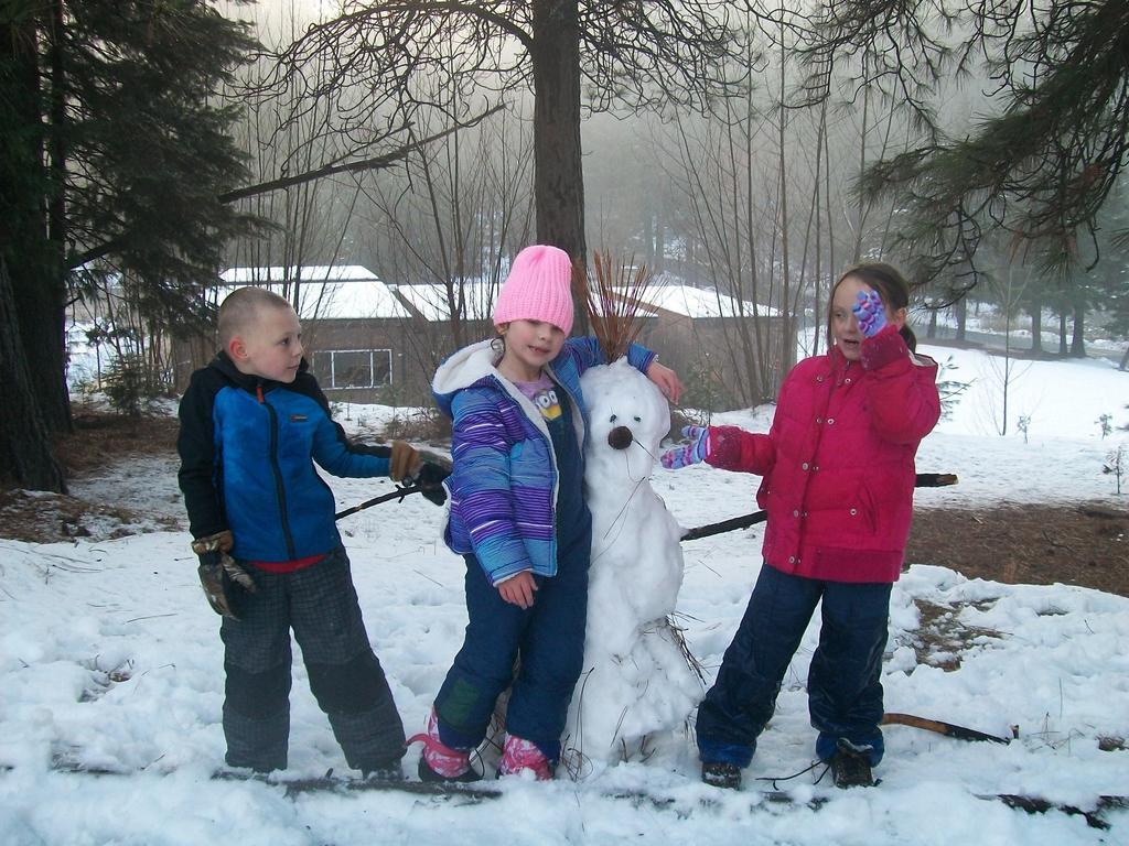 Children and a snowman
