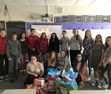 student council with holiday gifts for charity