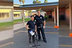 Officer Hwang and Student Displaying New Bike