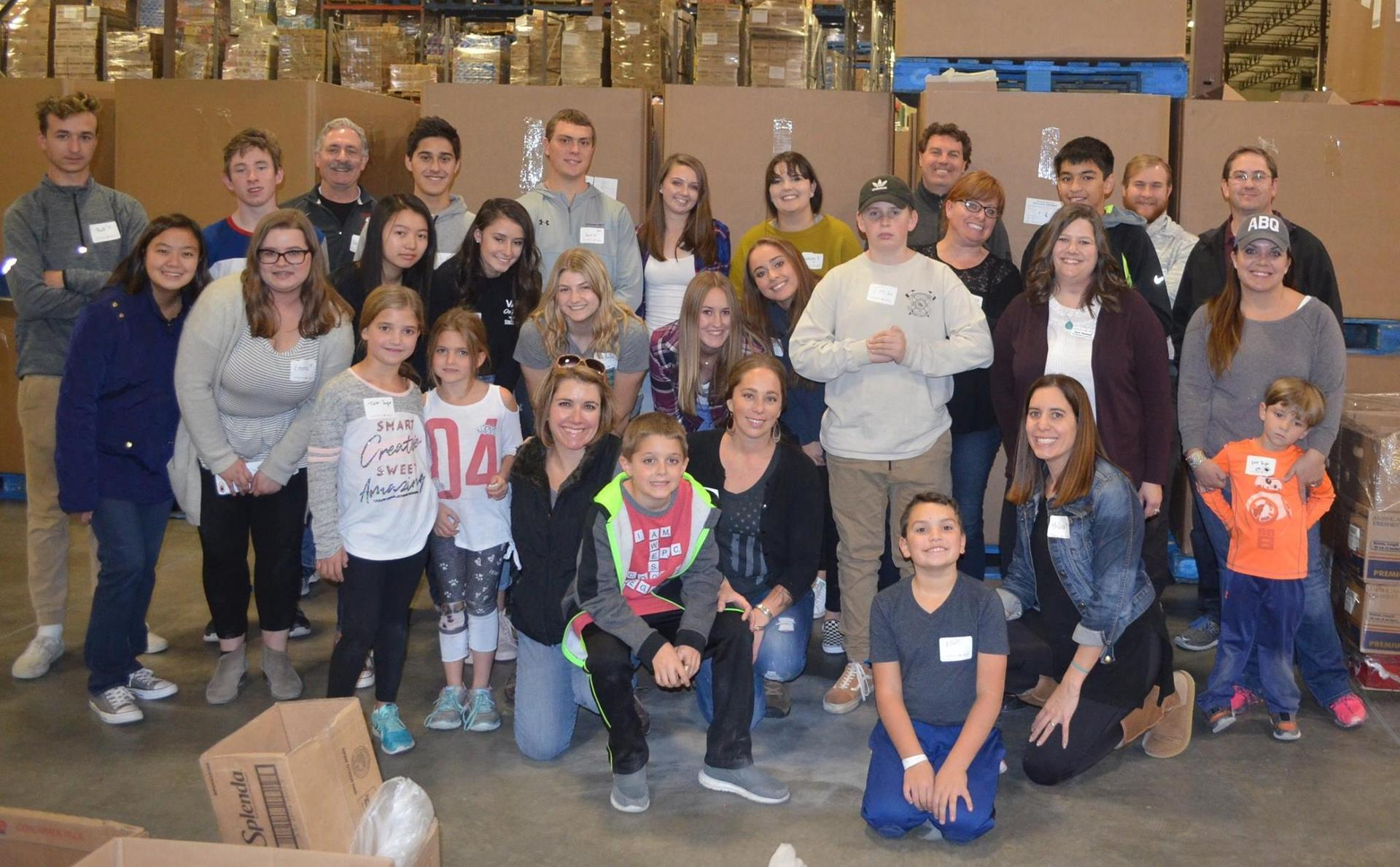 Each year committee members host an 'afternoon of service' at Roadrunner Food Bank. The volunteer initiative is well attended by both Prep students and alumni families.