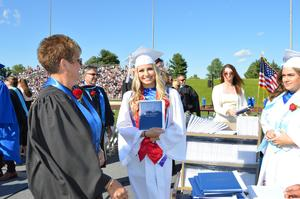BHS Senior Sydney Gold poses on the dais after receiving her diploma