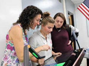 (L-R)  Engineering instructor Laura Doyle, sophomore Kathryn Evans, and senior Rebecca Wolfe use the hover camera feature on an interactive workstation in the new Innovation Classroom at Westfield High School.