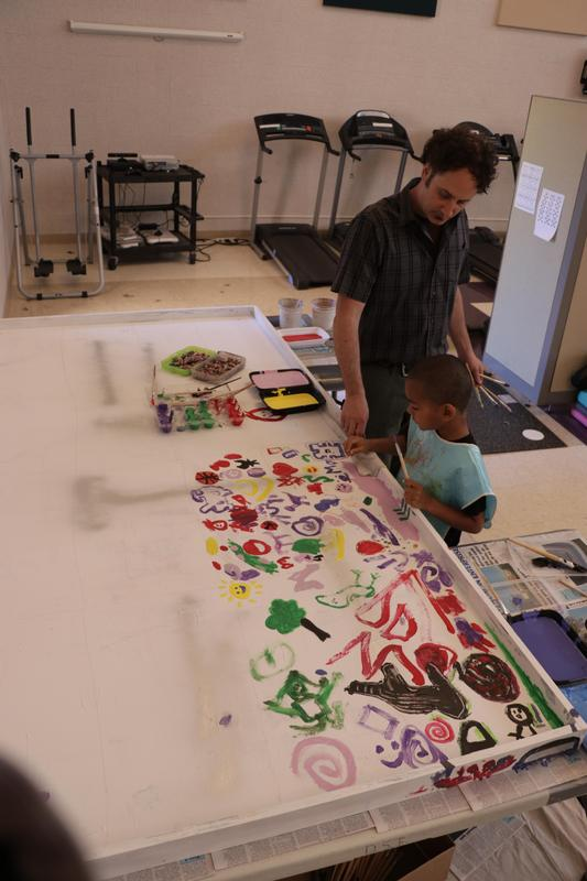 View from high above as Mr. Pavona helps a student on the painting.