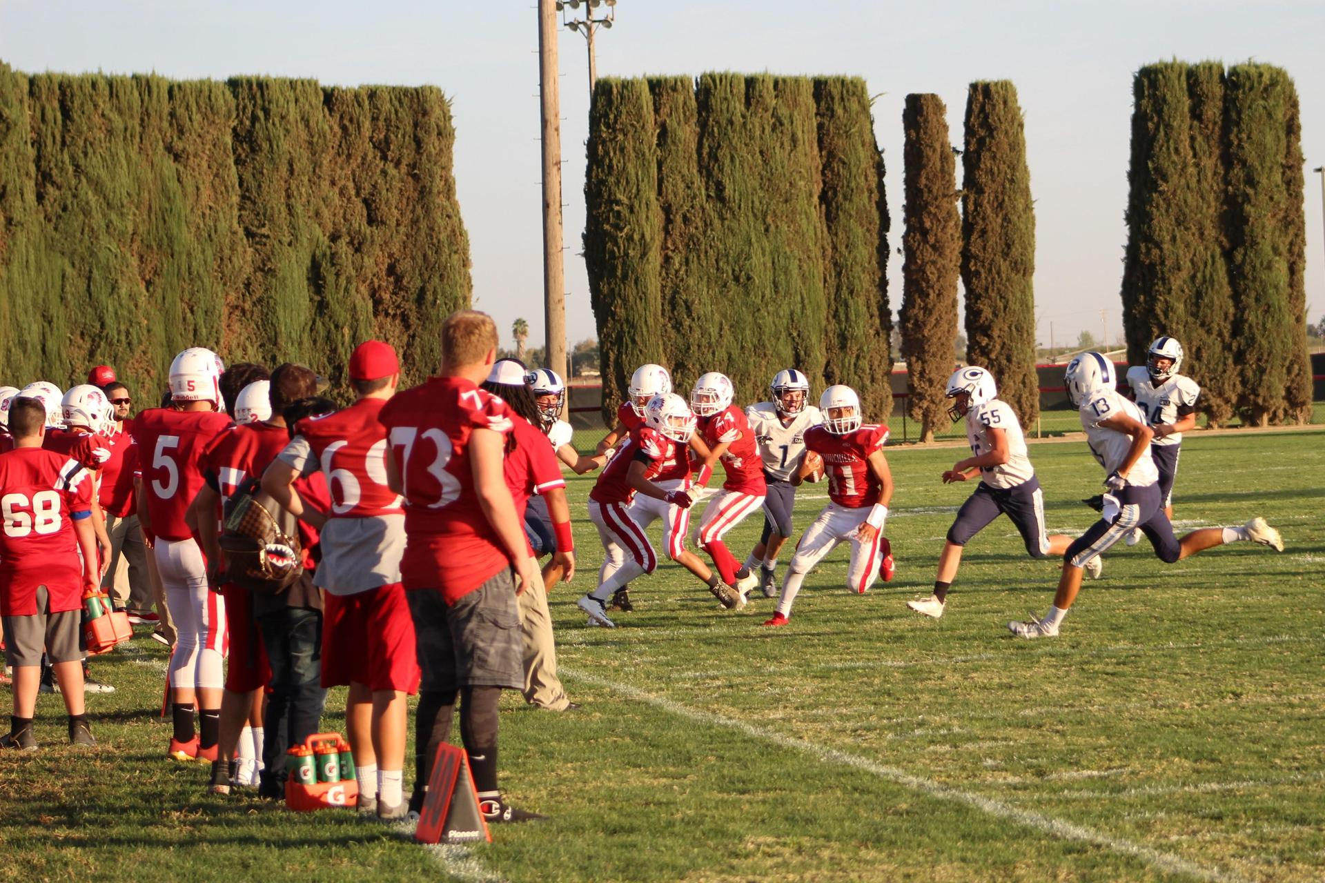 Junior Varsity boys playing football