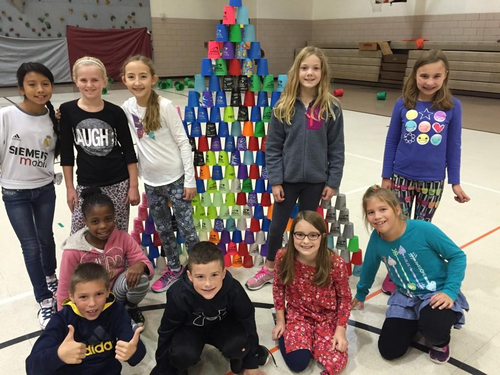 students celebrate their stack of cups