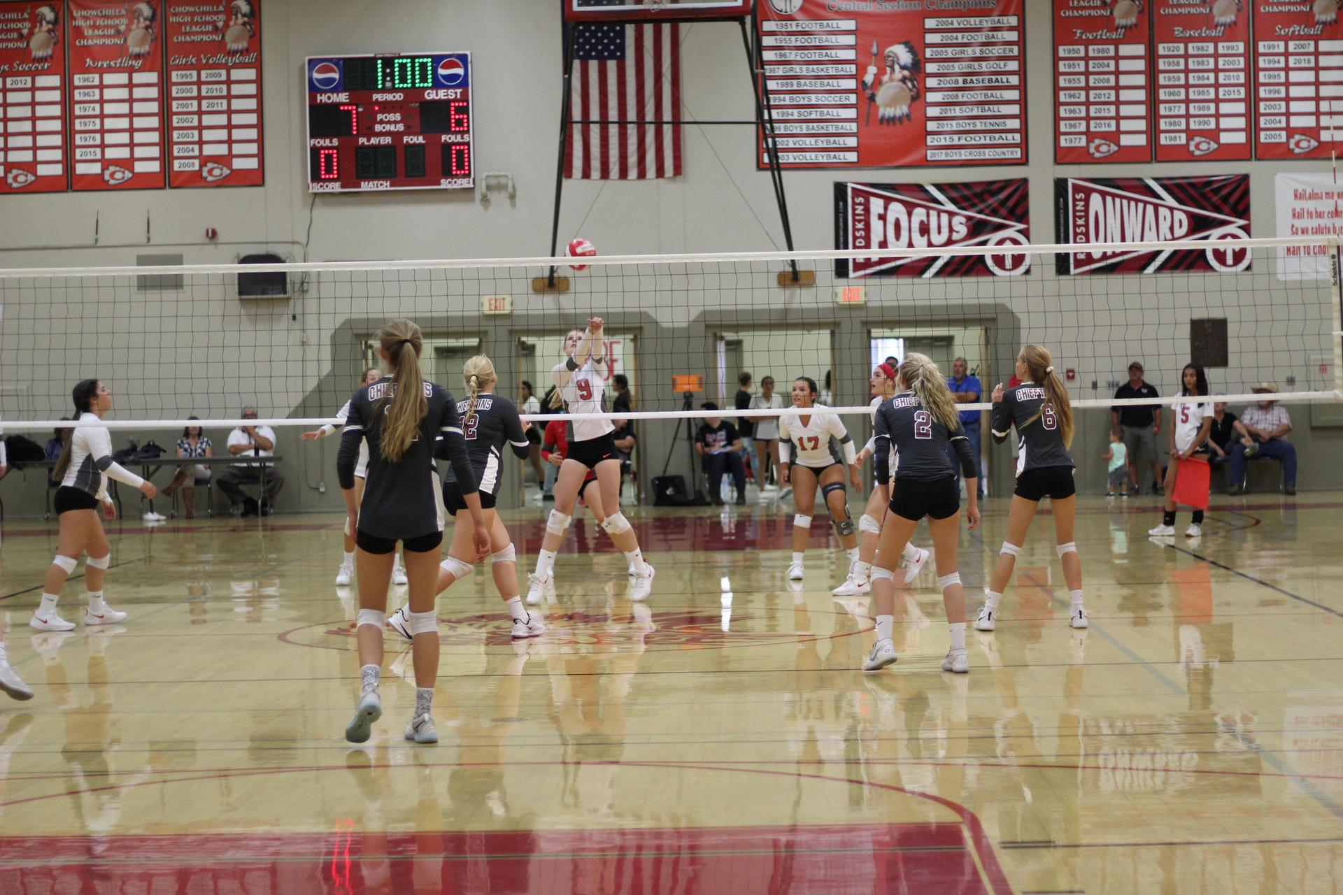 Varsity girls playing volleyball against Sierra