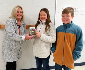 Page 5th graders present donations to local charities.