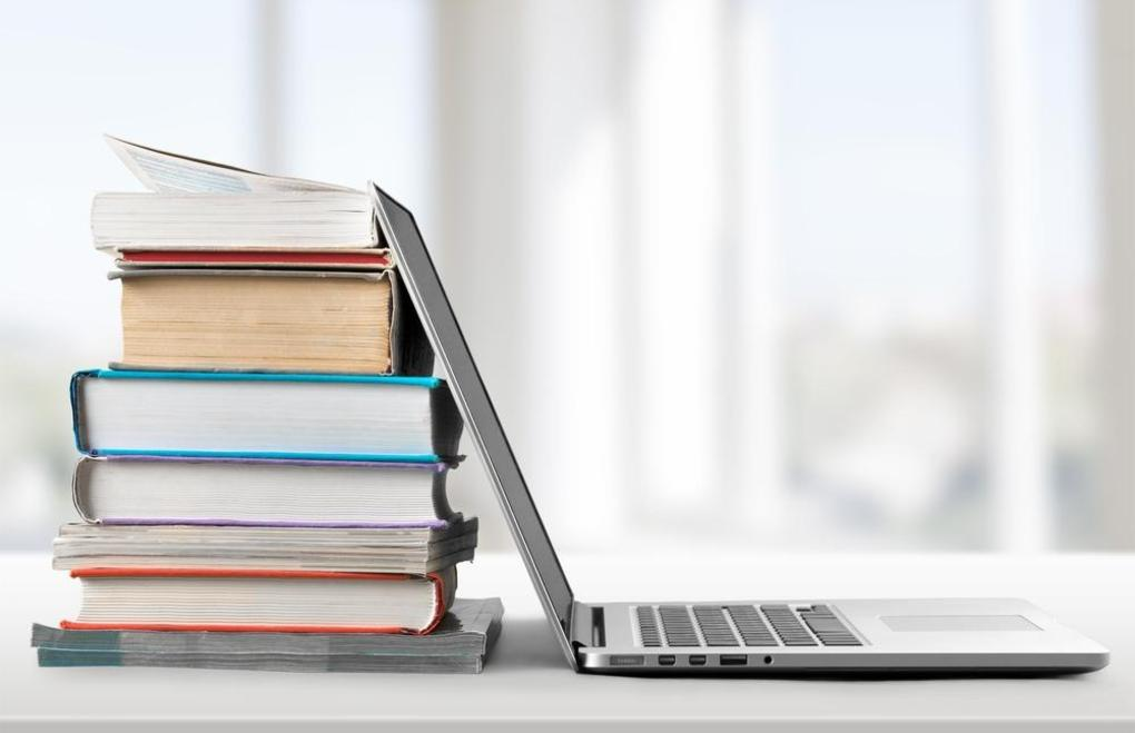 Picture shows textbooks and a chromebook.