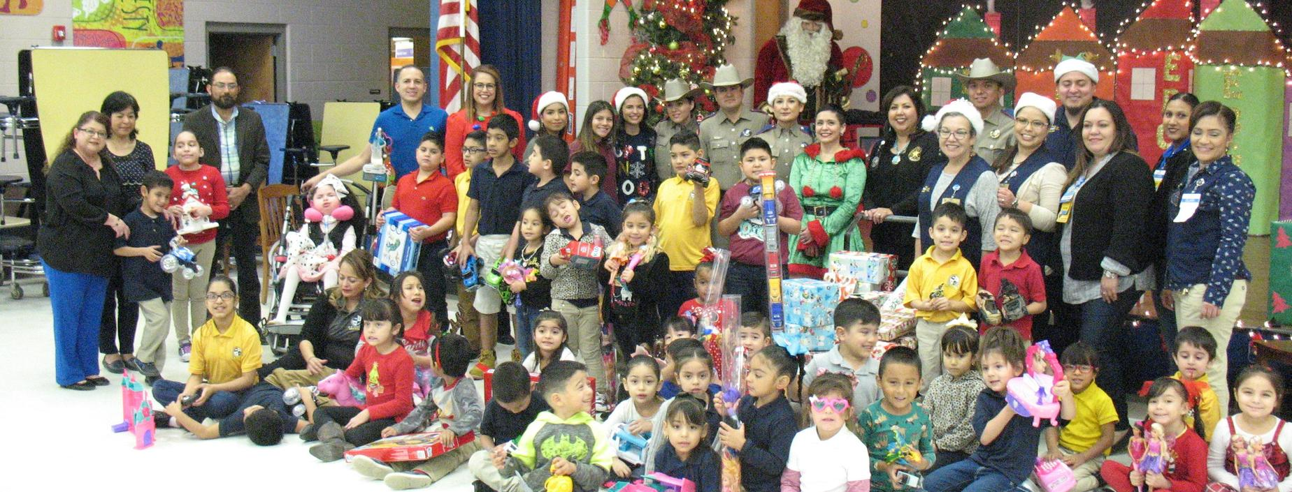 DPS troopers and Walmart associates bring gifts for Guerra students.