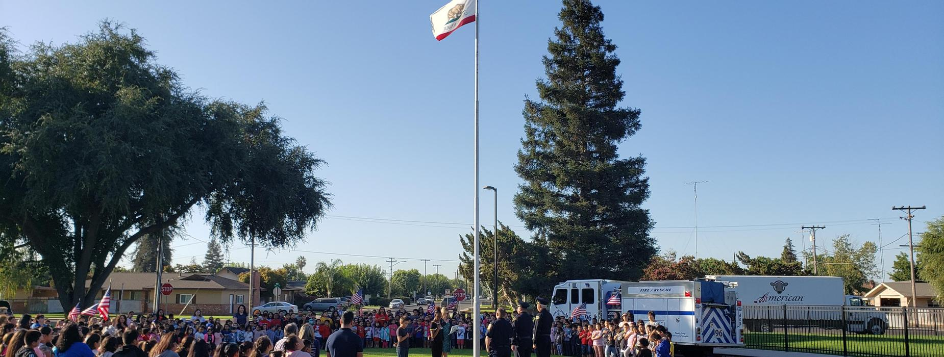 students, staff, and first responders pledging to the flag