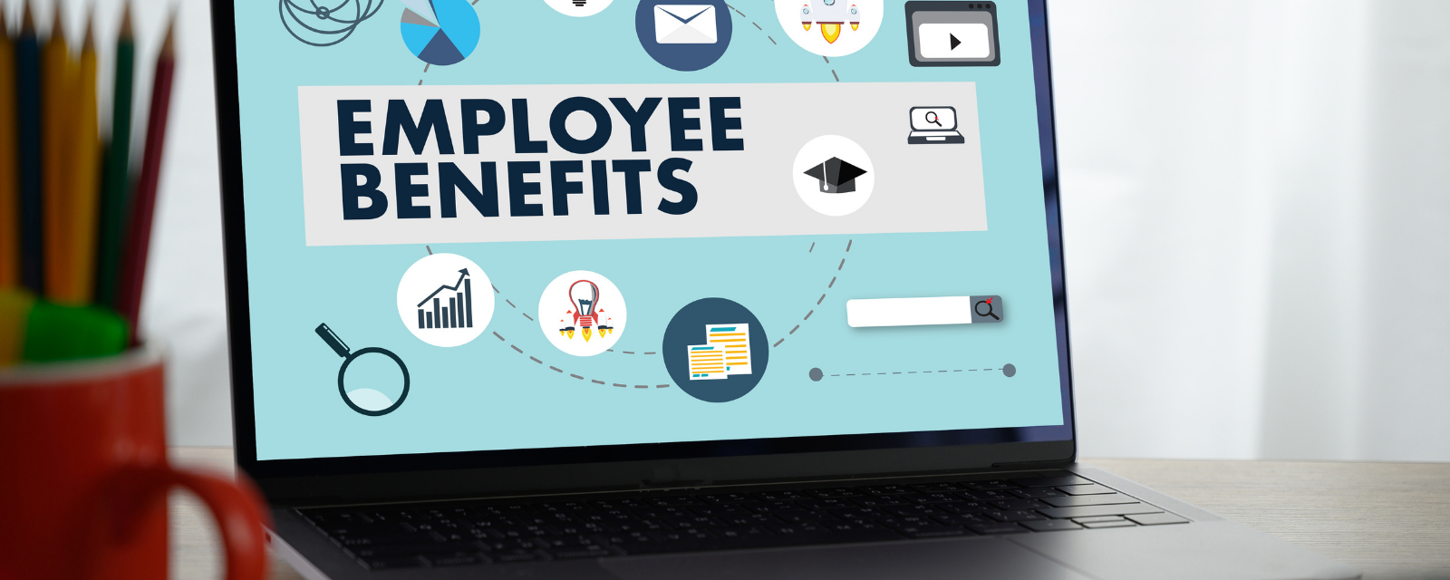 laptop open with employee benefits on the screen