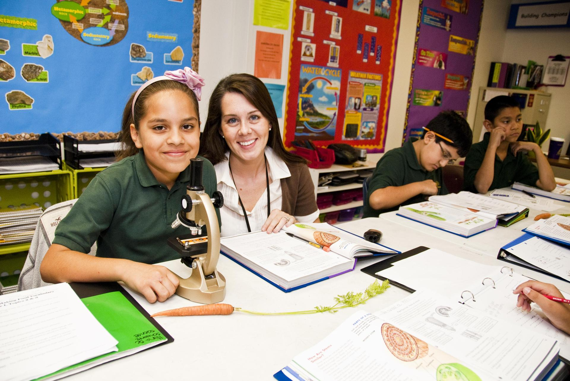 middle school female student and teacher
