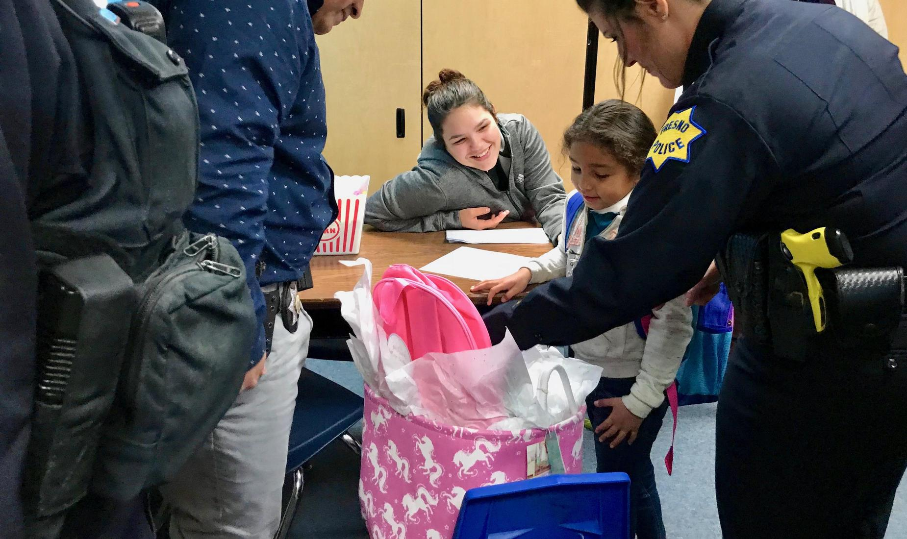 Madison student receiving a gift backpack